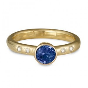 This Simple gold ring features a 5mm Sapphire with 1.5mm Diamond accents on the band. Please call for pricing and availability of other stone choices.